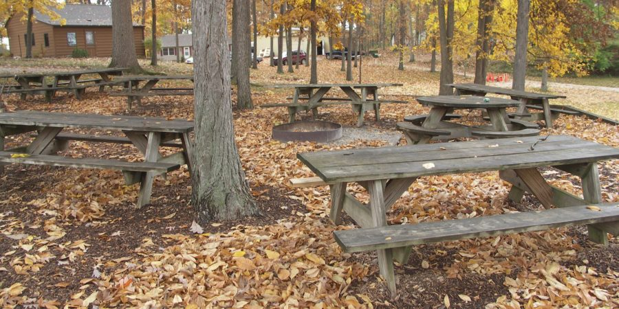 Picnic area tables near fire pit in fall