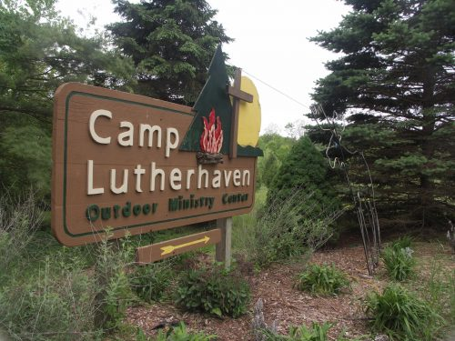 Camp Lutherhaven sign at entrance.